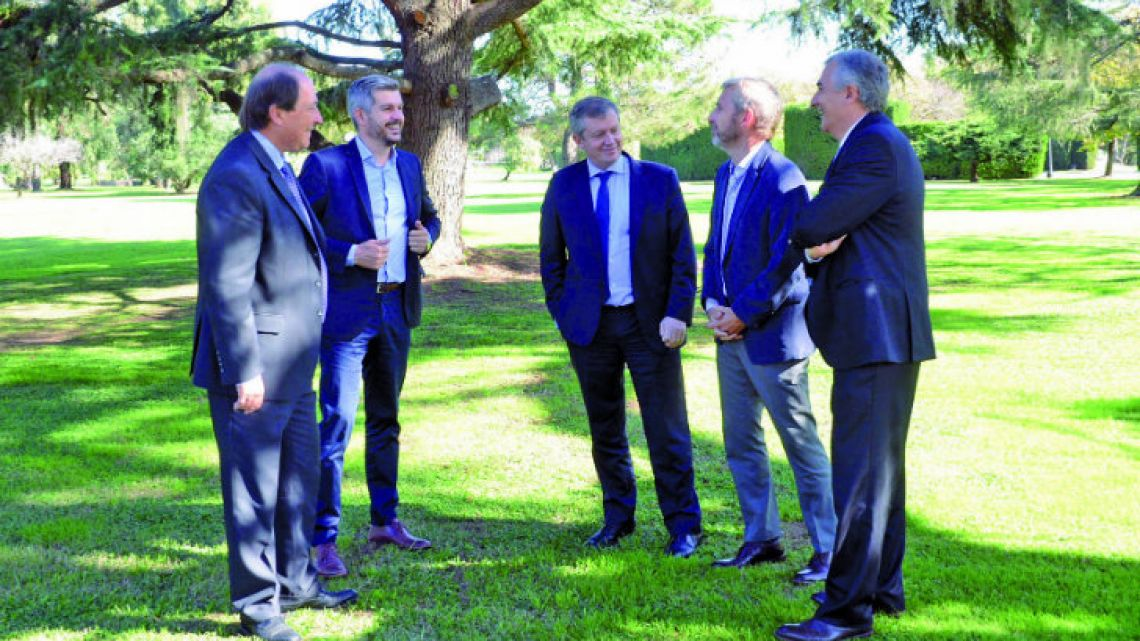 From left to right: UCR Radical party member Ernesto Sanz, Cabinet Chief Marcos Peña, Lower House Speaker Emilio Monzó, Interior Minister Rogelio Frigerio, and Governor of Jujuy province Gerardo Morales.