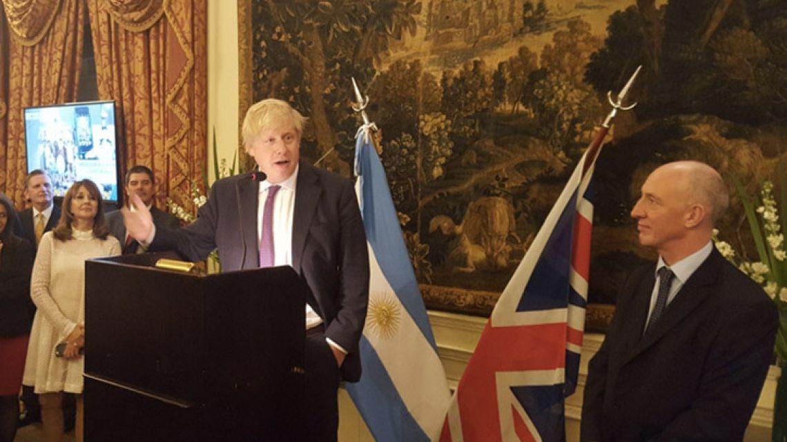 UK Foreign Secretary Boris Johnson addresses a crowd alongside British Ambassador to Argentina Mark Kent.