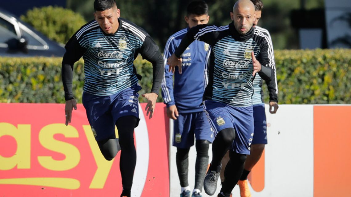 Javier Mascherano, right, and Marcos Rojo attend a training session in Ezeiza.