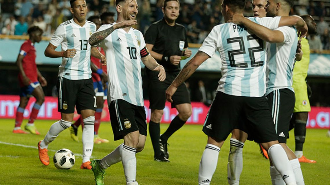 Lionel Messi, second right, celebrates with his teammates after scoring during a friendly football match between Argentina and Haiti in La Boca on Tuesday.