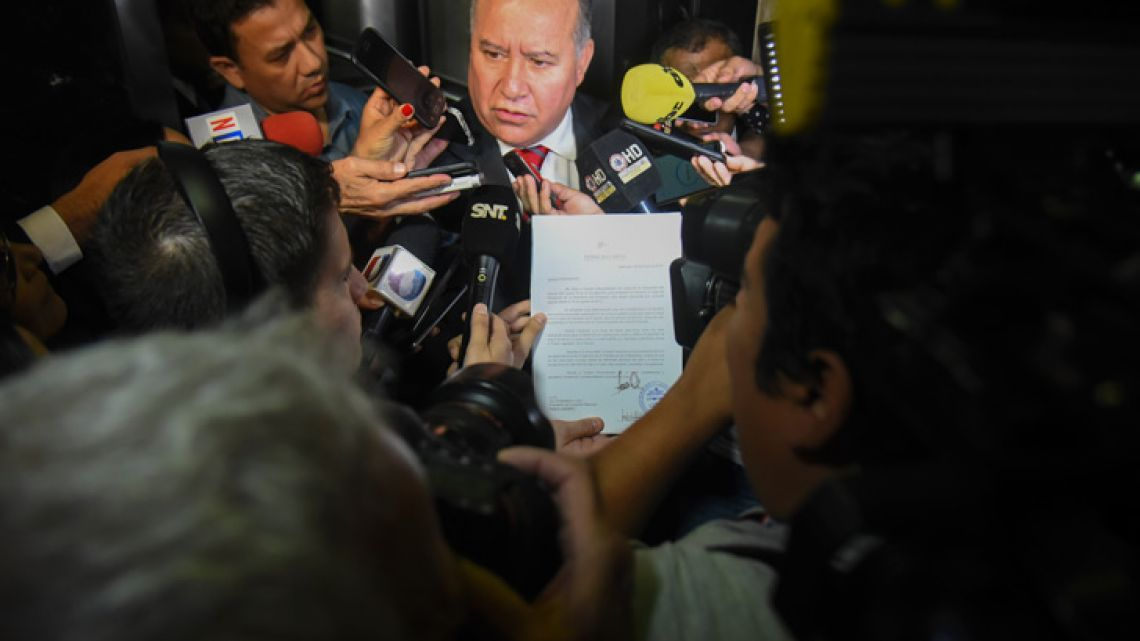 The private secretary of Paraguayan president Horacio Cartes, Dario Fiatiga, speaks to the press after presenting the letter of resignation of Cartes as president so he can take his seat as senator, in Asunción on May 28, 2018. Cartes' resignation paves the way for Vice-President Alicia Pucheta to take office temporarily until August 15 and make her the first woman to preside over Paraguay.