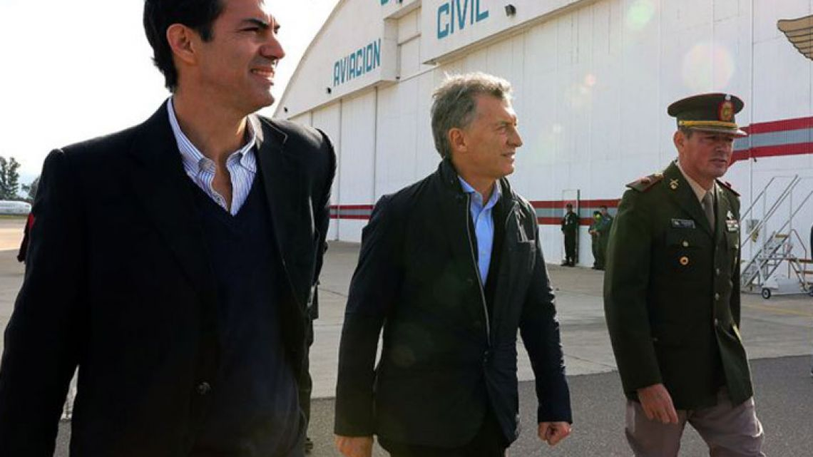 Salta governor Juan Manuel Urtubey (left) walks with President Mauricio Macri (centre) in Salta in May, 2018.