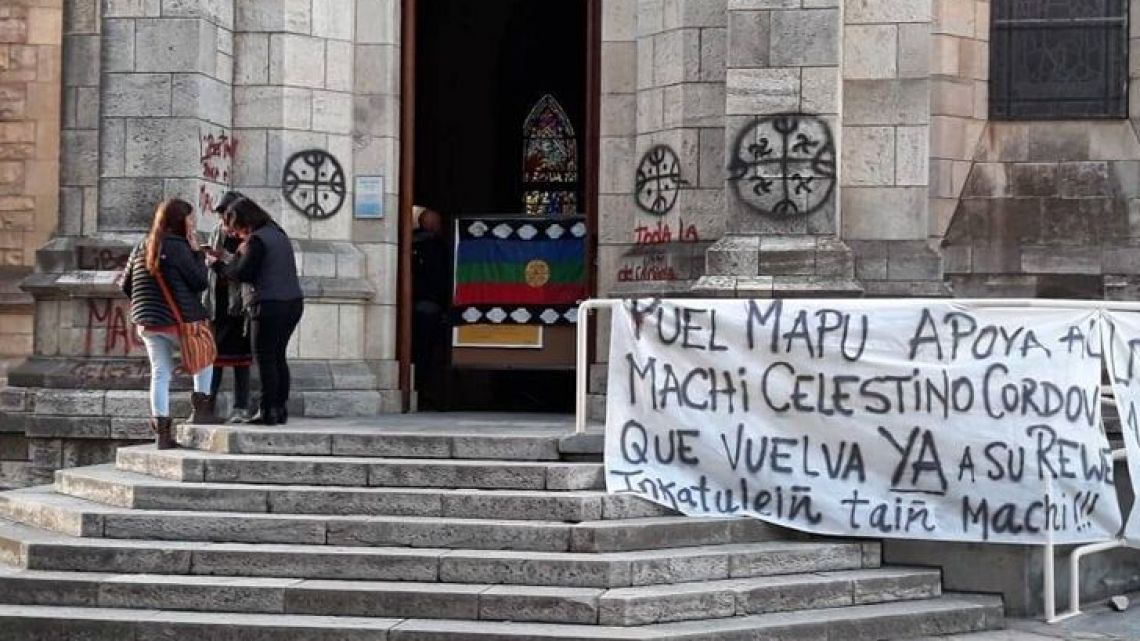 Mapuche graffiti and banner at the Cathedral of Bariloche.