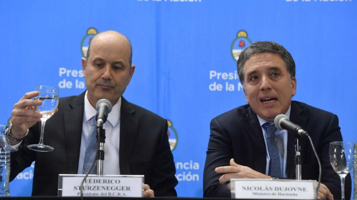Central Bank Governor Federico Sturzenegger and Treasury Minister Nicolás Dujovne.