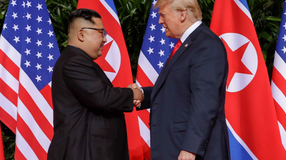 US President Donald Trump shakes hands with North Korea leader Kim Jong-un at the Capella resort on Sentosa Island Tuesday, June 12, 2018 in Singapore.