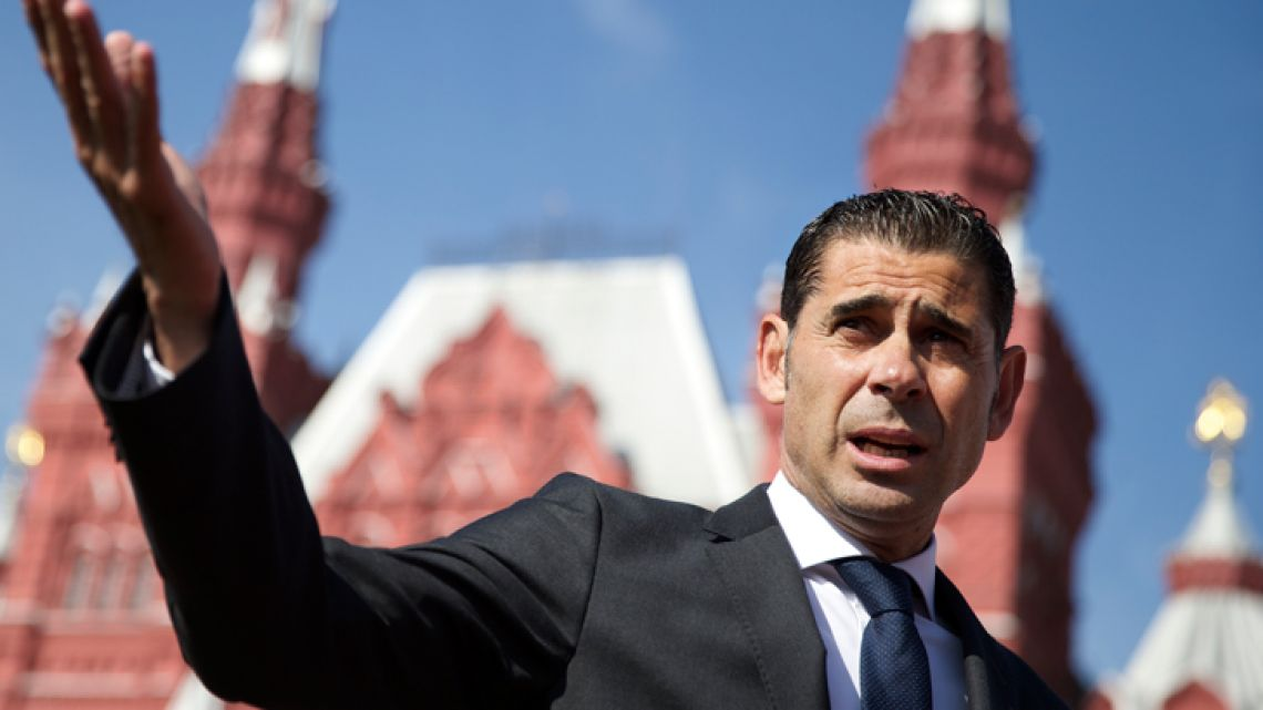 Spain's new manager, Fernando Hierro, gestures as he speaks with the media at Red Square in Moscow in this file photograph.