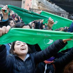 Pro-choice campaigners celebrate the approval of a bill legalising abortion by the lower house of Congress.