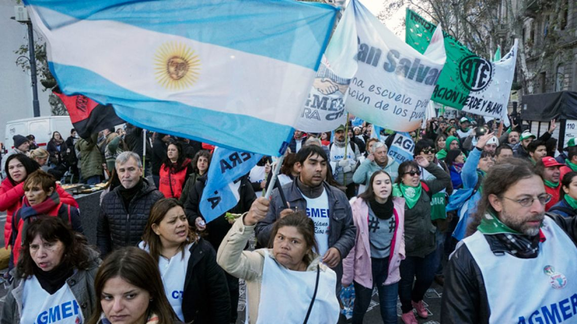 Workers march toward the Plaza de Mayo square earlier today, during a 24-hour strike called by state workers, truck drivers and teachers to reject the economic policies of Mauricio Macri's government.