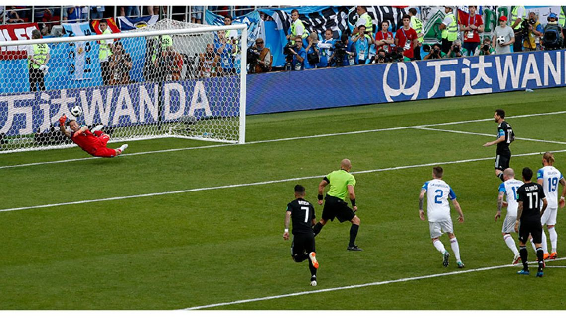 Iceland goalkeeper Hannes Þór Halldórsson saves a penalty attempt by Argentina's Lionel Messi during the Group D match between Argentina and Iceland at the 2018 World Cup in the Spartak Stadium in Moscow.