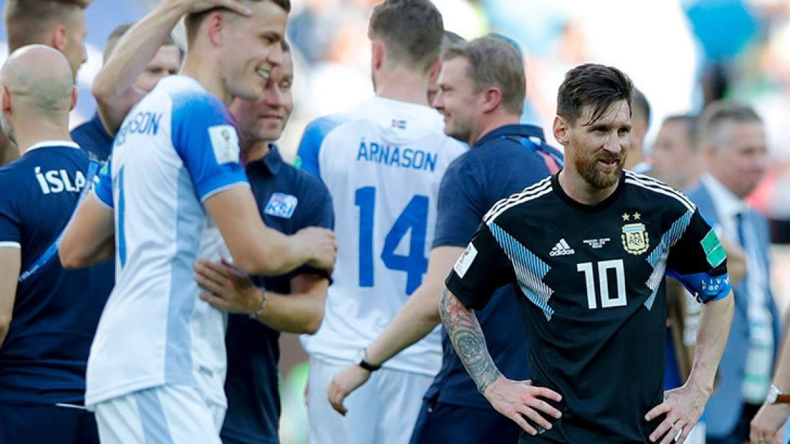 Lionel Messi looks downbeat as Iceland's players celebrate, at the end of the Group D match between Argentina and Iceland at the 2018 World Cup, at the Spartak Stadium in Moscow.