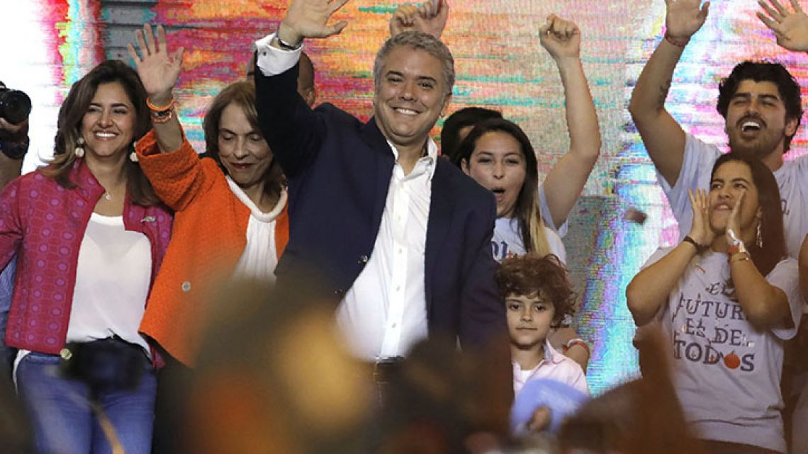 Newly elected Colombian president Ivan Duque (C) celebrates with supporters in Bogota, after winning the presidential runoff election on June 17, 2018