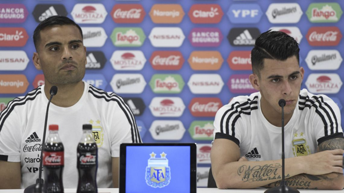 Gabriel Mercado (left) and Cristian Pavón attend a press conference at the team's base camp in Bronnitsy, near Moscow.