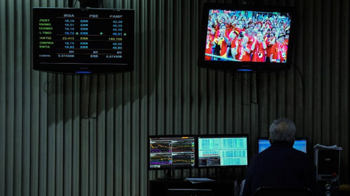 A trader works at the Buenos Aires Stock Exchange.