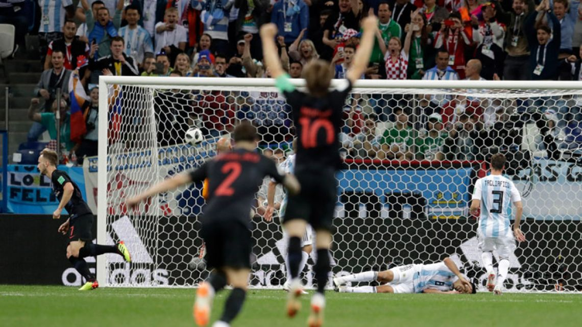 Croatia's Ivan Rakitic, far left, scores his side's third goal during the Group D match between Argentina and Croatia at the 2018 soccer World Cup in Nizhny Novgorod Stadium on Thursday.