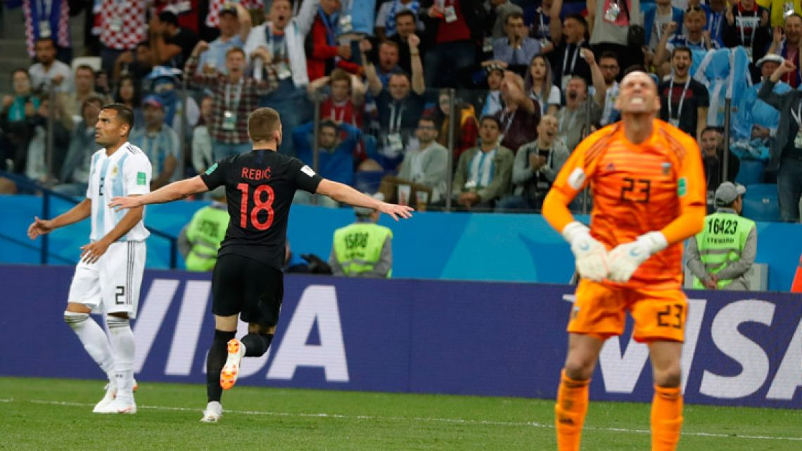 Croatia's Ante Rebic celebrates scoring the opening goal during the Group D match between Argentina and Croatia, Thursday, June 21, 2018.