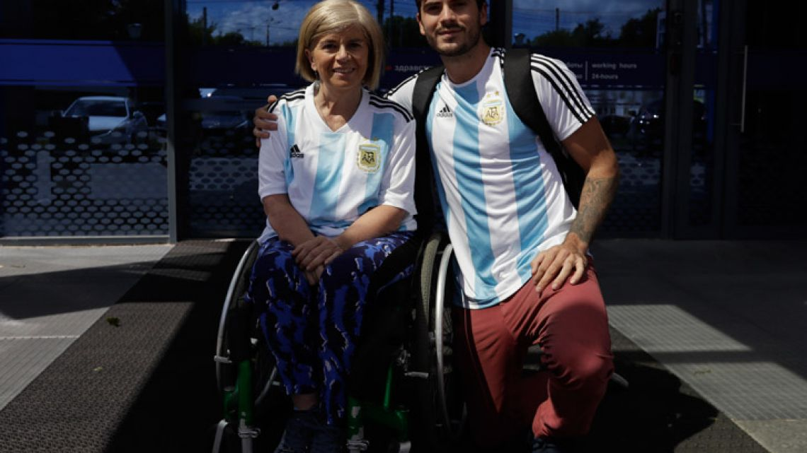 Argentina fans Nora Espector, left, and her son Emil Davisson pose for a photograph.