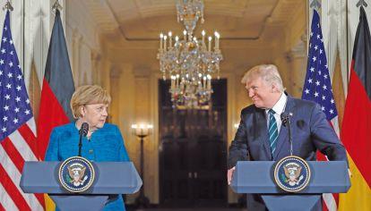 Proteccionismo. Las políticas de Trump lo enfrentan con aliados como Merkel.