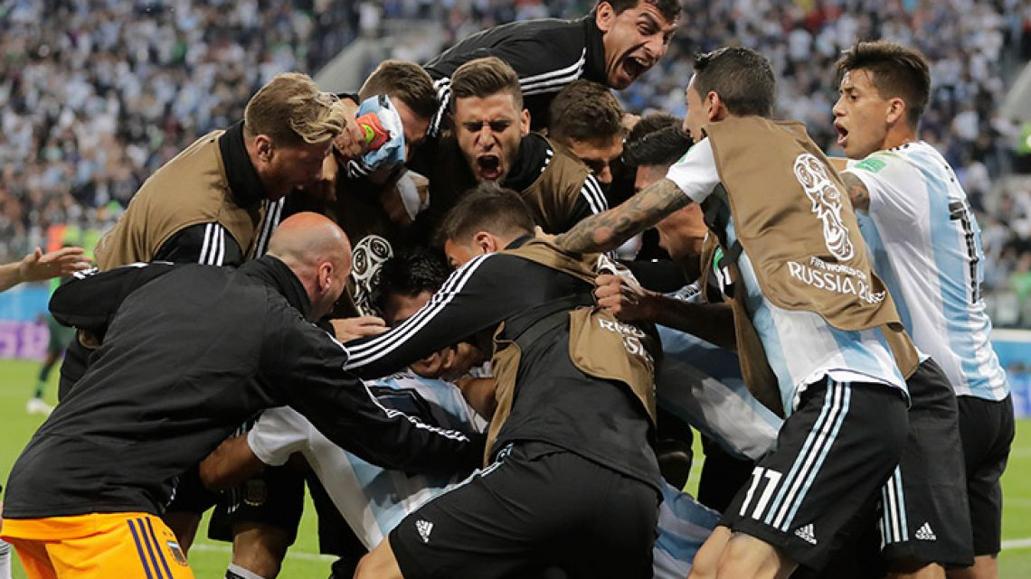 Argentina's players and coaching staff celebrate after defender Marcos Rojo's goal during the Group D match between Argentina and Nigeria in St. Petersburg.