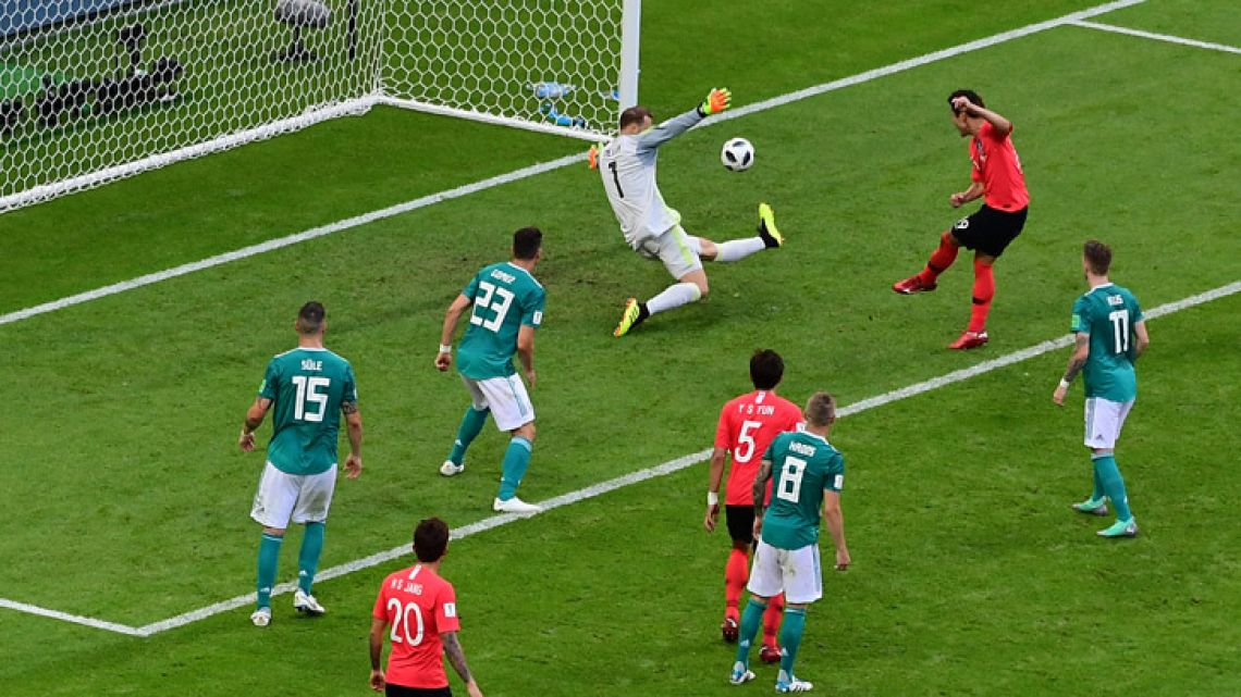 South Korea's defender Kim Young-gwon shoots to score past Germany's goalkeeper Manuel Neuer during the Russia 2018 World Cup Group F football match between South Korea and Germany at the Kazan Arena on June 27, 2018.