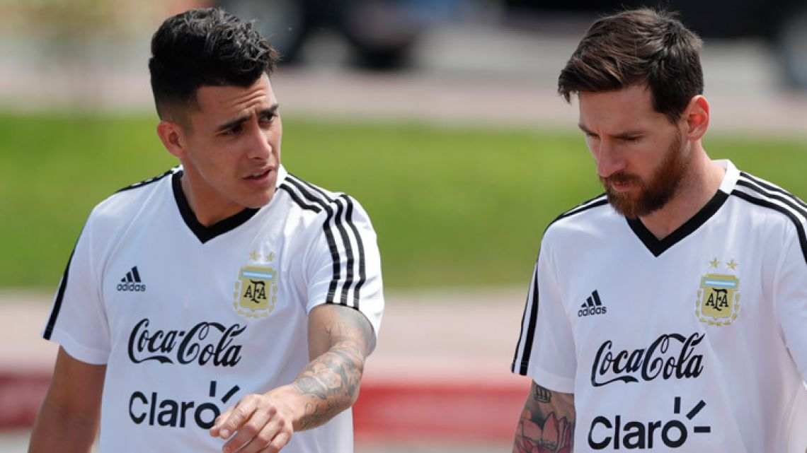 Cristian Pavón talks to Lionel Messi during a training session in Bronnitsy, Russia.