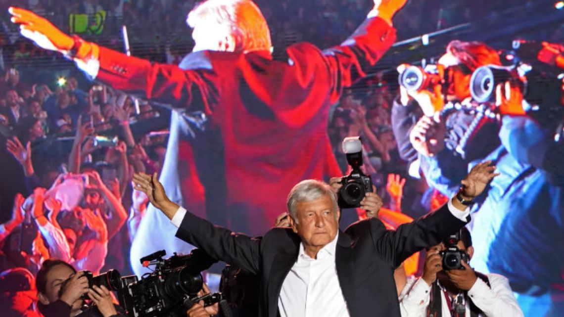 Candidate López Obrador waves to supporters at his closing campaign rally.
