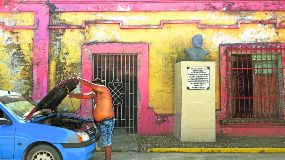 A bust honouring AMLO is seen in front of the house where his grandparents once lived in Tepetitán.