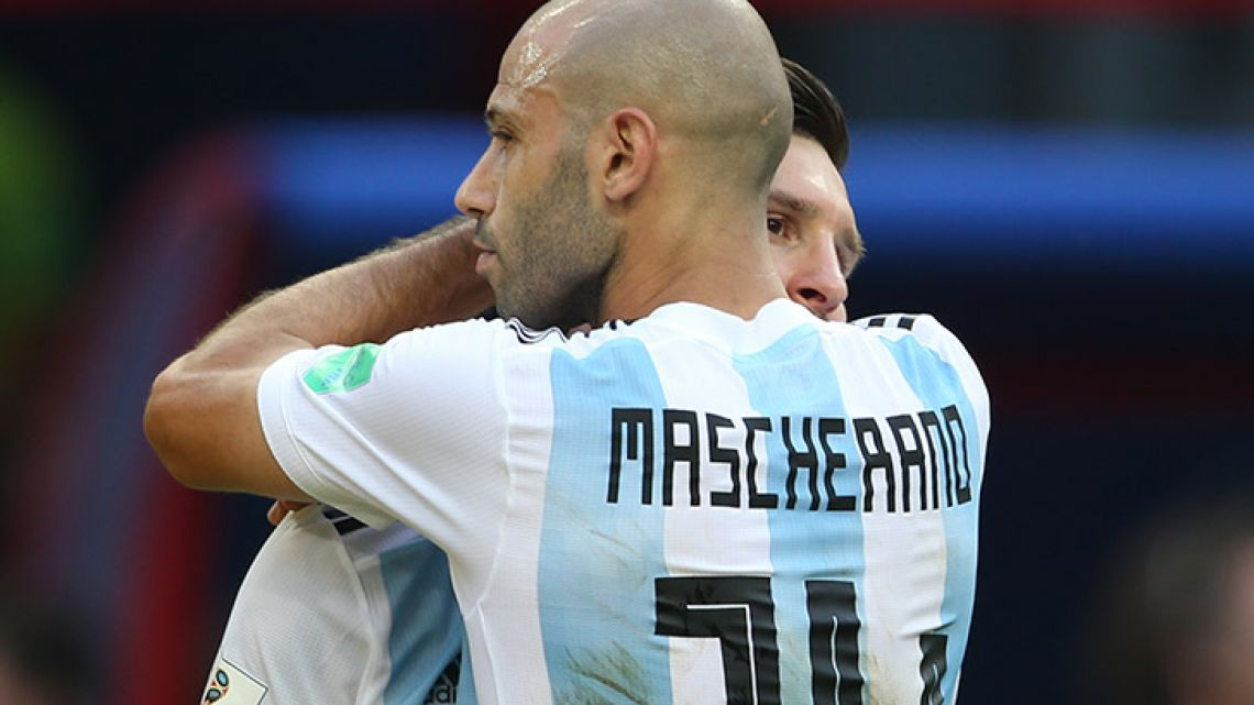 Javier Mascherano hugs Lionel Messi after Argentina's 4-3 loss to France at the Kazan Arena.