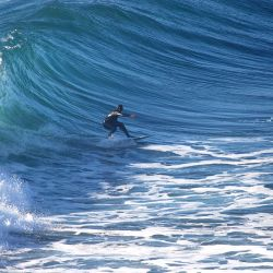 A surfer on the break at Punta de Lobos.