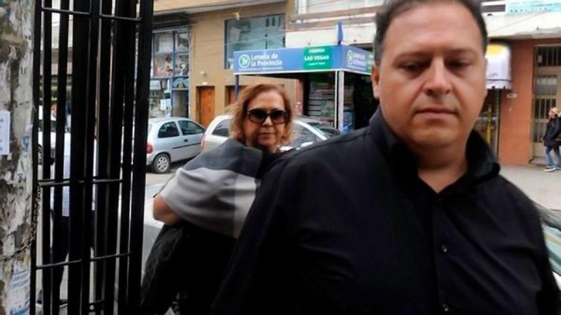 María Isabel Santos Caballero, wife of the late drug-lord Pablo Escobar, and his son, Juan Sebastián Marroquín Santos face charges in a federal court.