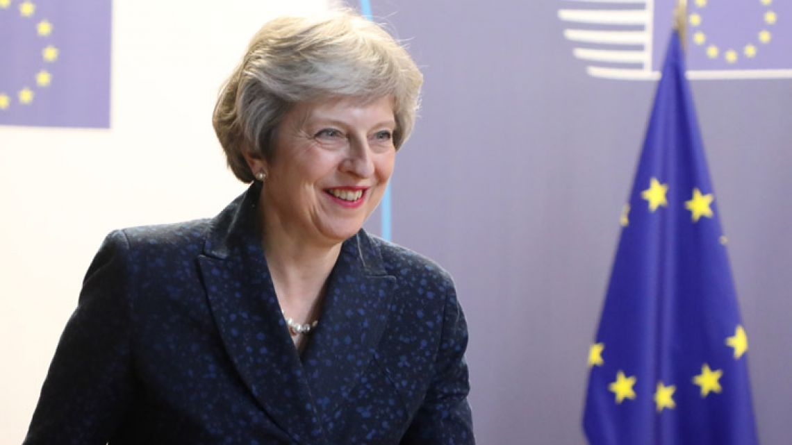 British Prime Minister Theresa May speaks to the press before leaving the first day of a European Union summit focused on migration, Brexit and eurozone reforms in Brussels.