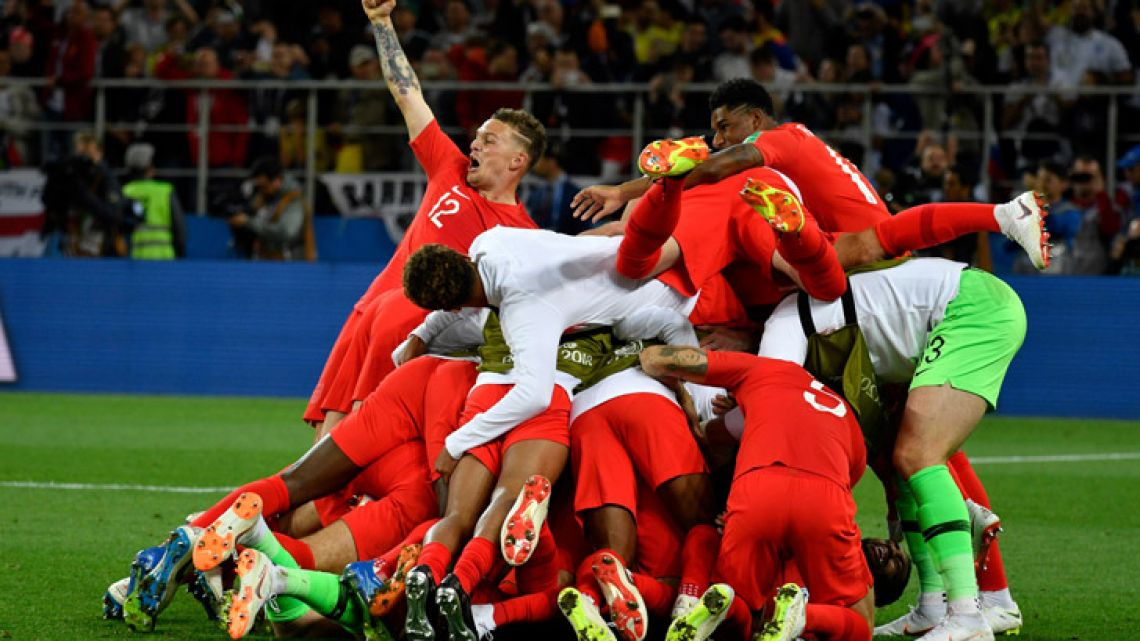 England's players celebrate winning the penalty shoot-out at the end of the Russia 2018 World Cup round of 16 football match between Colombia and England at the Spartak Stadium in Moscow.
