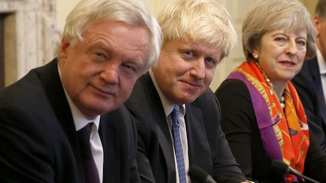 In this photo taken on November, 2016, British Prime Minister Theresa May (right) sits with members of her Cabinet, including British Secretary of State for Exiting the European Union (Brexit Minister) David Davis (left) and British Foreign Secretary Boris Johnson.