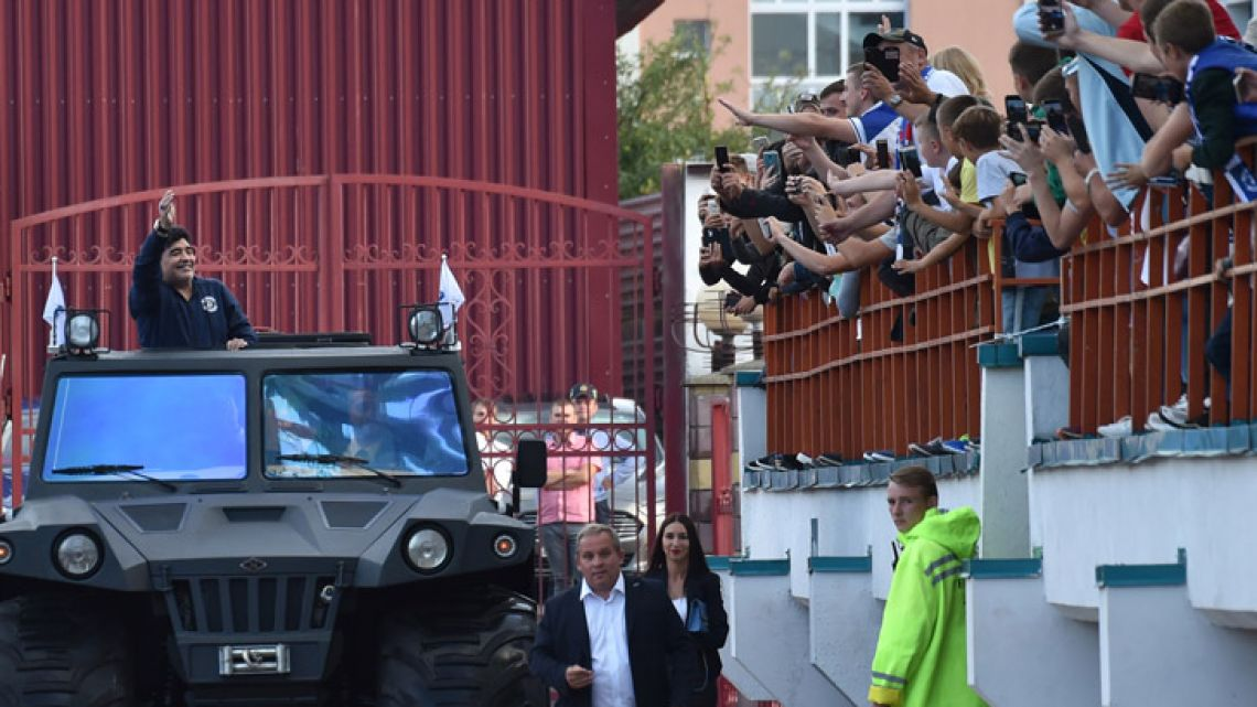Diego Maradona waves to supporters during his unveiling as the new chairman of the board of Dynamo Brest.
