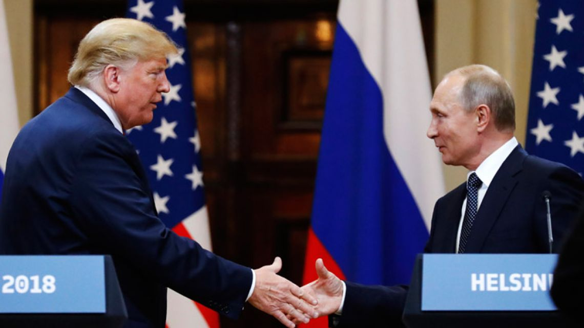 US President Donald Trump shakes hand with Russian President Vladimir Putin at the end of their joint press conference after their meeting at the Presidential Palace in Helsinki, Finland, on Monday.