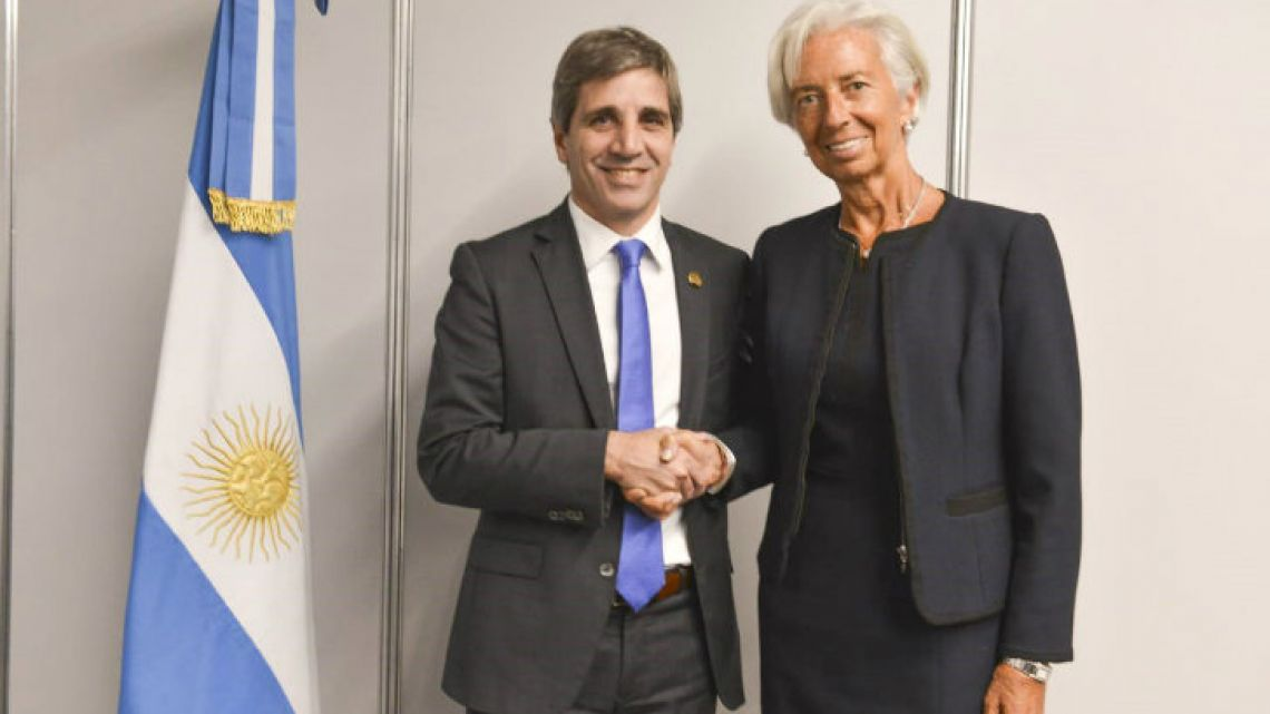 International Monetary Fund (IMF) chief Christine Lagarde meets with Central Bank President Luis Caputo yesterday in Buenos Aires.