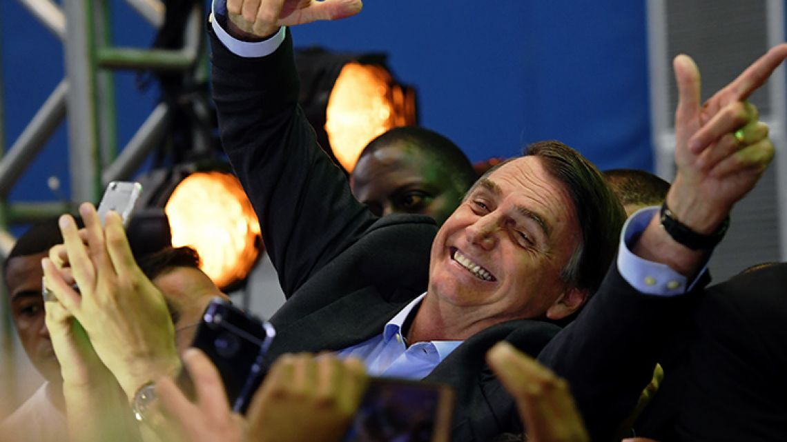 Jair Bolsonaro is greeted by supporters as he launches his campaign for the Brazilian presidency for October's national election, in Rio de Janeiro, Brazil, on Sunday.