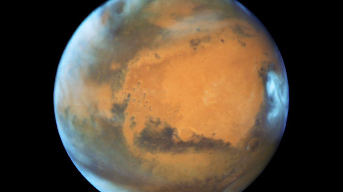 This May 12, 2016 image provided by NASA shows the planet Mars. A study published Wednesday, July 25, 2018 in the journal Science suggests a huge lake of salty water appears to be buried deep in Mars, raising the possibility of finding life on the red planet.