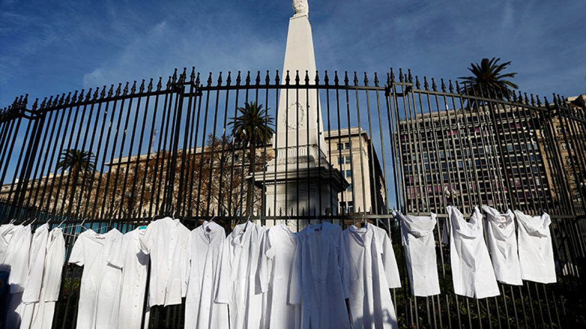White medical coats hanging from the iron gate that surrounds the national monument May Pyramid, as a symbolic act against efforts to legalize abortion.