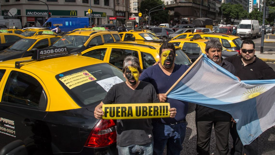 Taxi-drivers in Buenos Aires City stage a protest against the arrival of Uber into Argentina, in this file photograph taken in 2017.