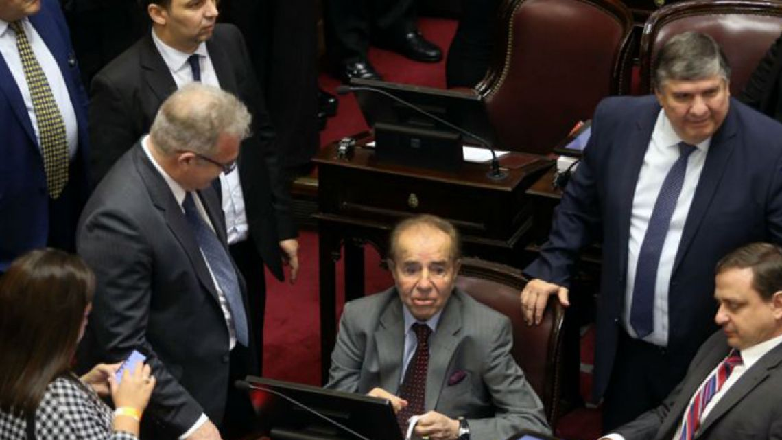 Former president-cum-Senator Carlos Menem is surrounded by his Senate colleagues during the 2018 abortion decriminalisation vote.