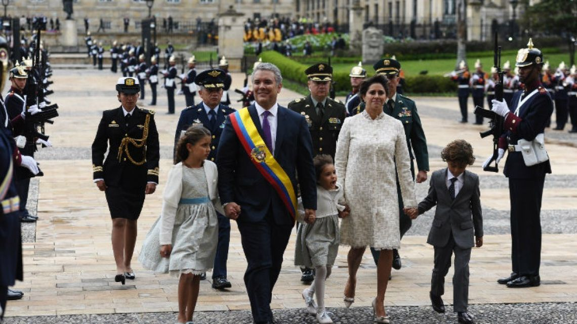 Iván Duque arrives at the presidential palace with his wife, María Juliana Ruiz, and children, after his inauguration ceremony in Bogotá on Tuesday.