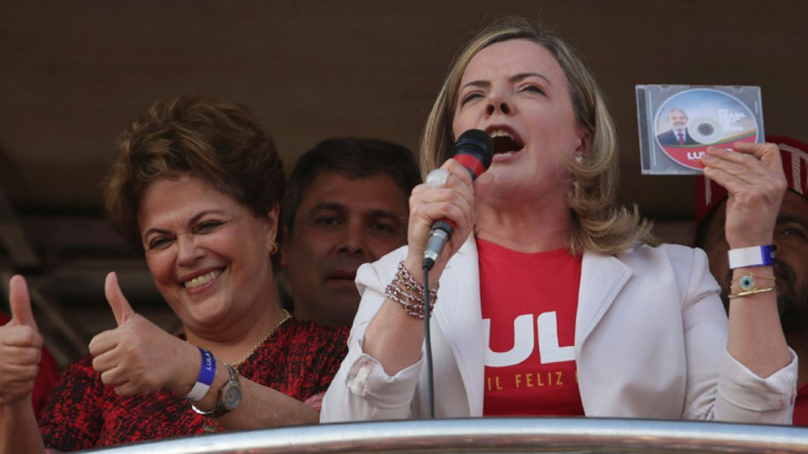 Former Brazil president Dilma Rousseff with Workers Party Senator Gleisi Hoffman rally in Lula's defence at a rally in Brasilia on August 15, 2018.