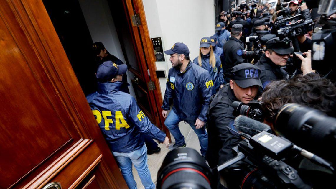 Police enter the home of former president and senator for Buenos Aires Province Cristina Fernández de Kirchner.