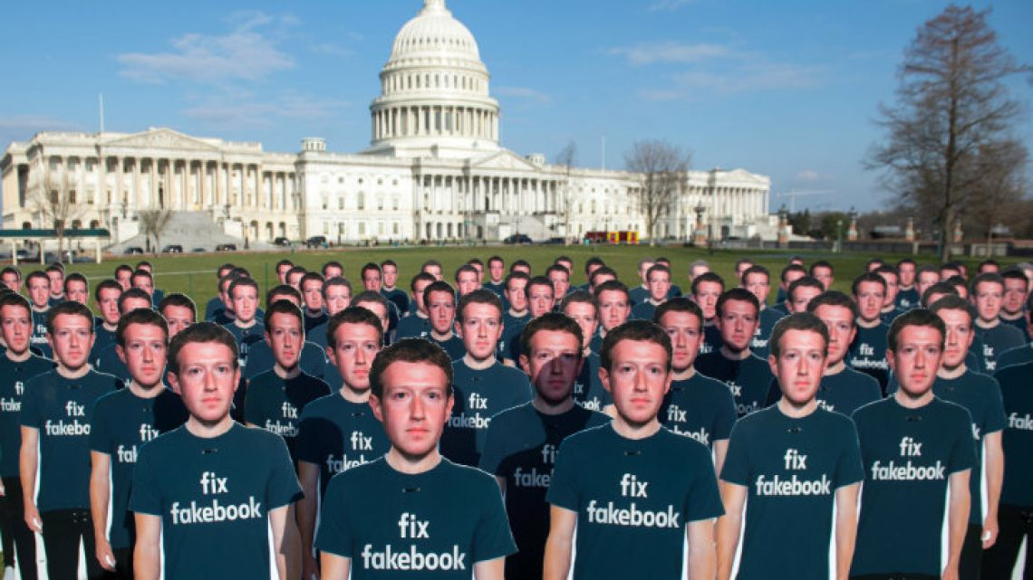 One hundred cardboard cutouts of Facebook founder and CEO Mark Zuckerberg stand outside the US Capitol in Washington.