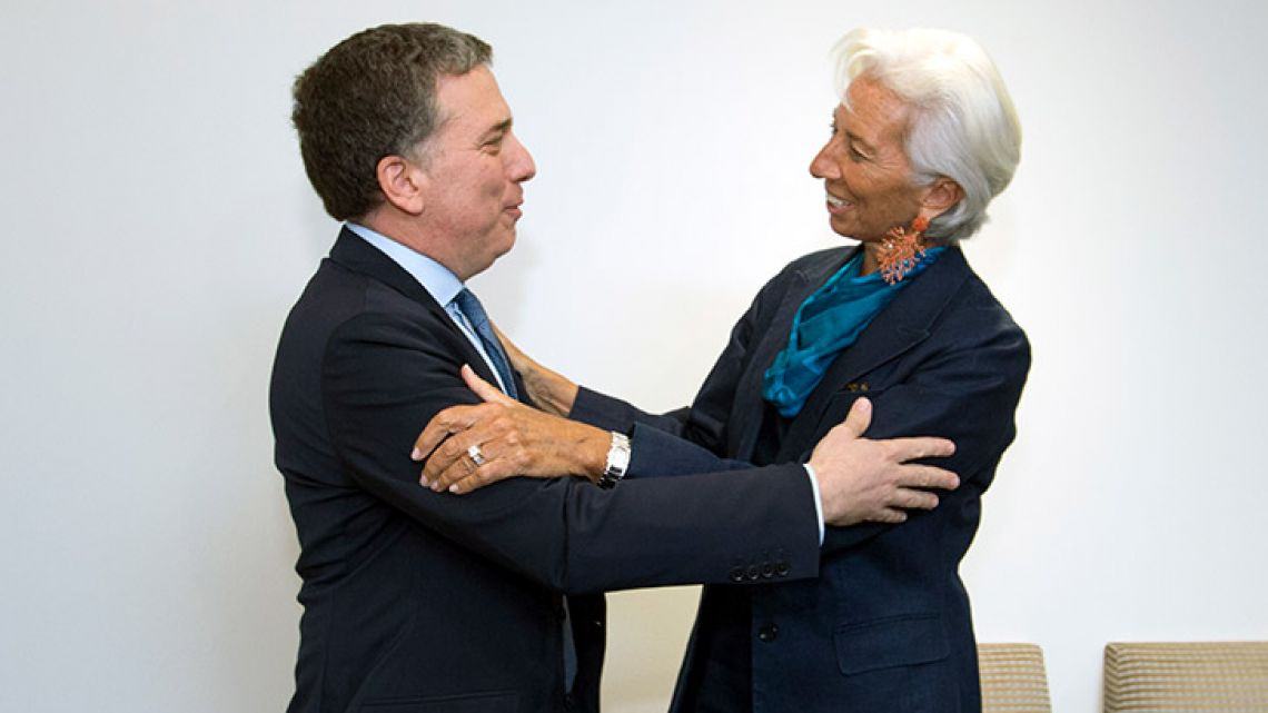 Treasury Minister Nicolás Dujovne greets International Monetary Fund (IMF) Managing Director Christine Lagarde before a private meeting at the IMF's headquarters in Washington on Tuesday.