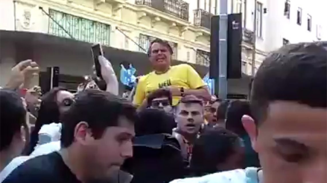 This still taken from an online video shows Jair Bolsonaro reacting after he was stabbed during a campaign rally in Brazil