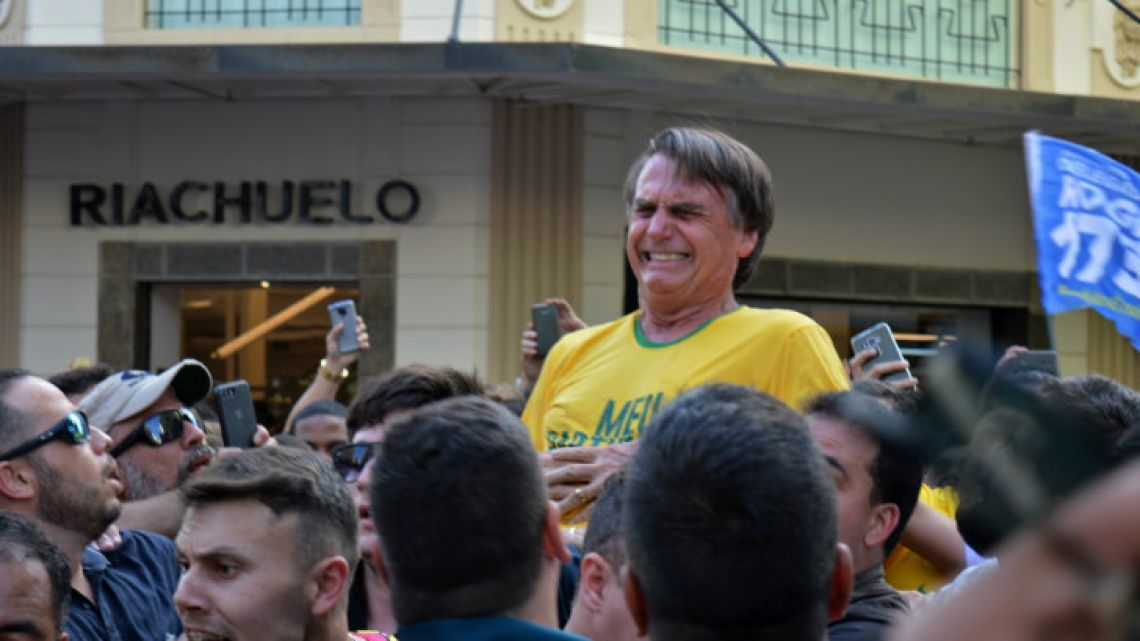 Presidential candidate Jair Bolsonaro reacts after being stabbed in the stomach during a campaign rally in Juiz de Fora, Minas Gerais state, on Thursday.