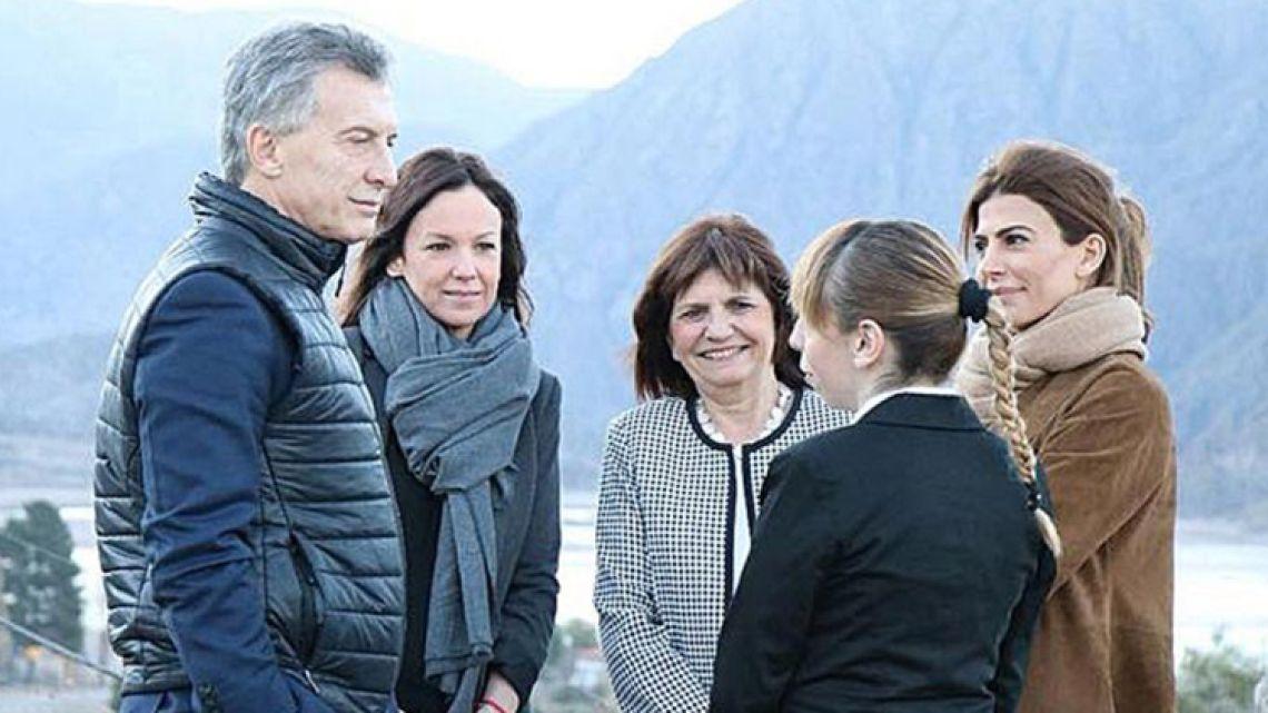 President Mauricio Macri seen alongside Social Development Minister Carolina Stanley (second left) and Security Minister Patricia Bullrich (centre).
