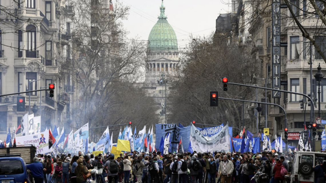 Demonstrators, backdropped by the Congress building, block Avenida 9 de Julio in Buenos Aires, where they gathered to protest against the government of President Mauricio Macri, and installed a soup kitchen to distribute free meals on September 12, 2018. Social organisations are demanding the declaration of a food emergency amid a financial crisis that has increased and give away food rations as a means of protest against the government.