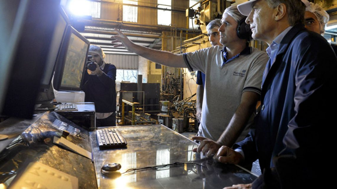 President Mauricio Macri meets employees at a factory, in this file photo taken in 2017.